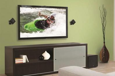 TV and 2 speakers on wall